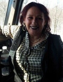 """Lucy has enjoyed a love for trucking and the transportation industry from a youth watching those """"Big Trucks"""" roll. Lucille and Jose partnered in life and in business 6 years ago. Together they continued as Contractors for the #1 Relocation Van Line """"United Van Lines, and the distinguished Agency, Hilldrup Companies. Lucille has gained the respect of all she has worked with. They recognize Lucille's attention to details and her constant monitoring eye over every aspect of LGGC. Critical management of safety compliance issues, customer service, booking and routing is just scratching the surface of Lucy's attention to the smooth operation of LGGC. Lucille not only over sees the office operation ,oh no you can't keep this always reaching woman behind a desk, she is right there in the cab of """"The Lyon Truck"""" driving. She contacts clients, shippers, brokers and communicates all movements, concerns and ETA schedules of arrivals/ departures. She also is quick to """"put the gloves on"""" in assisting in the loading & unloading of the """"High Value"""" products & materials we haul."""